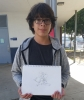 Eighth grader Matthew holding his art  LAUREN LEE, STAFF PHOTOGRAPHER