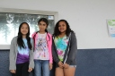 Sarah, Grace, and Isabel wearing bright, colorful, spring-season clothing.
