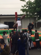 Students try out Mr. Lu's jousting booth.